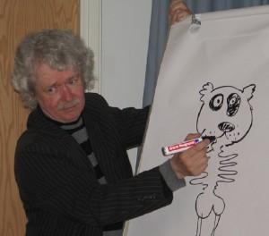 Jukka Lemmetty piirtää avajaisissa